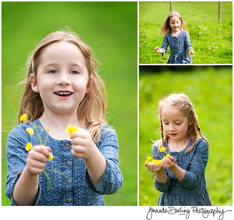 Twin girls with buttercups by lifestyle family photographer Amanda Darling