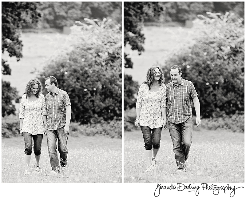Relaxed Parents walking through field of buttercups by Amanda Darling photography