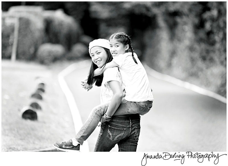 sisters piggyback photography in Kingswood Surrey
