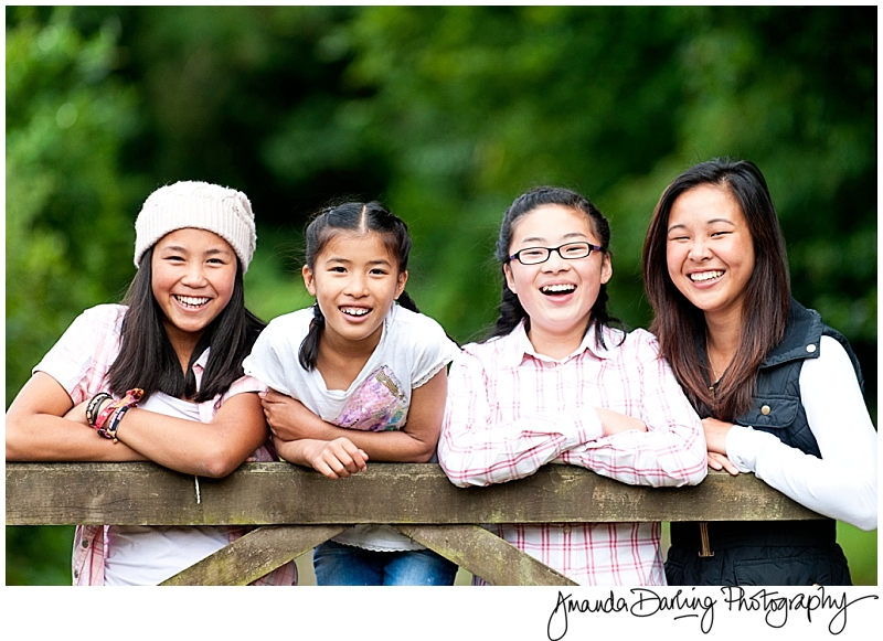 Four girls laughing together by Surrey Family Photographer Amanda Darling